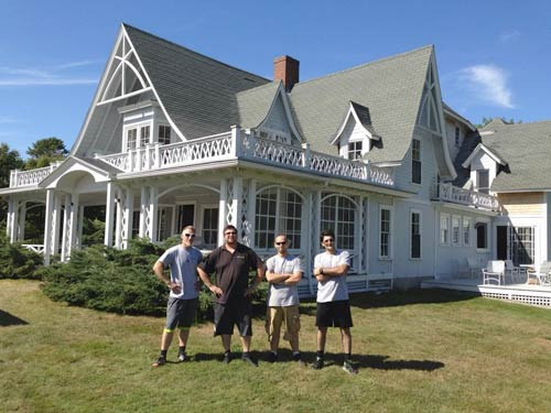 Professional moving company team outside a house in Portland, ME